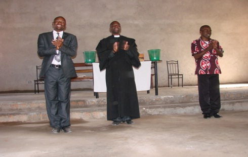 Mr Chimba Katuka (Left), Reverend Chipendano(middle) and Elder Chilufya David(Right) singing and giving praise to the Lord.